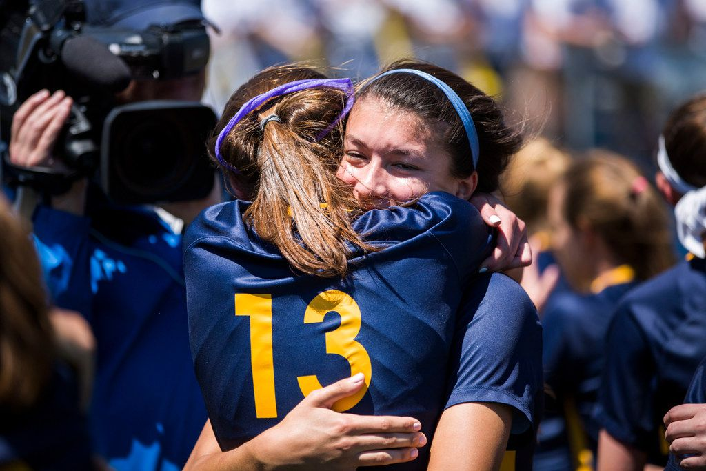 Highland Park players Ryan Bozeman (13) and Maja Davison (23) hug after winning the UIL conference 5A girls state final soccer game between Mansfield Legacy and Highland Park at Birkelbach Field in Georgetown, Texas on Saturday, April 20, 2019. Highland Park beat Mansfield Legacy 2 to 0.