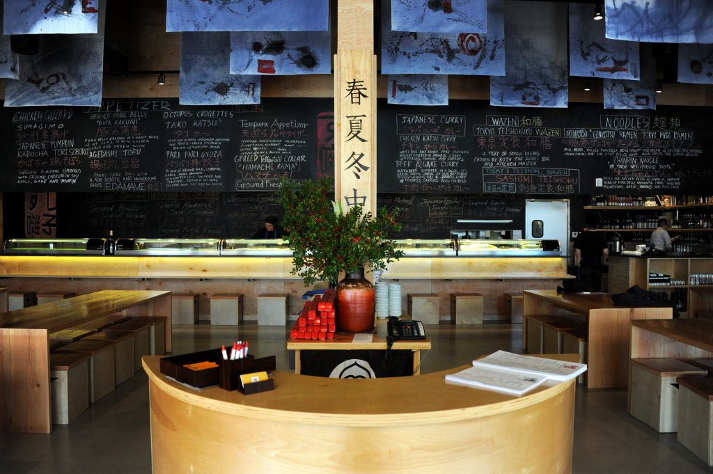 Guests can sit at either the community tables or the sushi bar at Sushi Bayashi in Trinity Groves in Dallas, TX on February 19, 2015.
