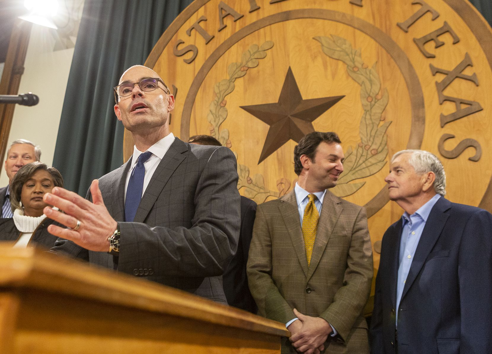 At Bonnen's announcement Monday that he has the votes to become speaker, standing behind him were two GOP state representatives who were said to have been helpful in rallying GOP members behind his candidacy -- Fort Worth's Craig Goldman, right of Bonnen and wearing a gold tie, and Muenster's Drew Springer, far left.