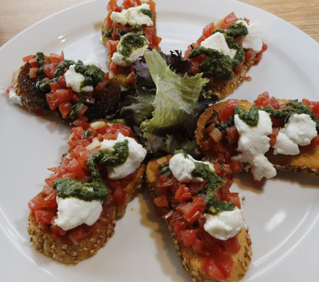 Bruschetta, an appetizer from the lunch menu photographed Monday December 14, 2015, at the new Coal Vines located across from the Omni Dallas Hotel. Crispy crostini's topped with marinated tomatoes and basil, finished with goat cheese. (Ron Baselice/The Dallas Morning News)