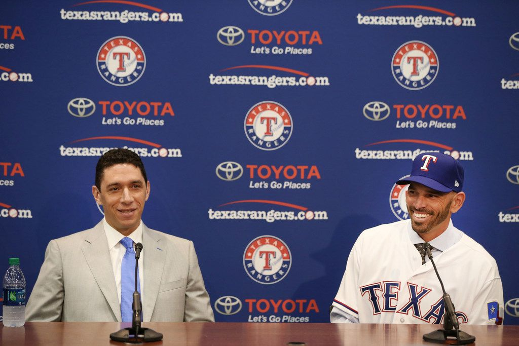 Texas Rangers' new manager Chris Woodward (right) laughs with General Manager Jon Daniels during a press conference announcing his position at Globe Life Park in Arlington, Texas on Monday, Nov. 5, 2018. (Rose Baca/The Dallas Morning News)