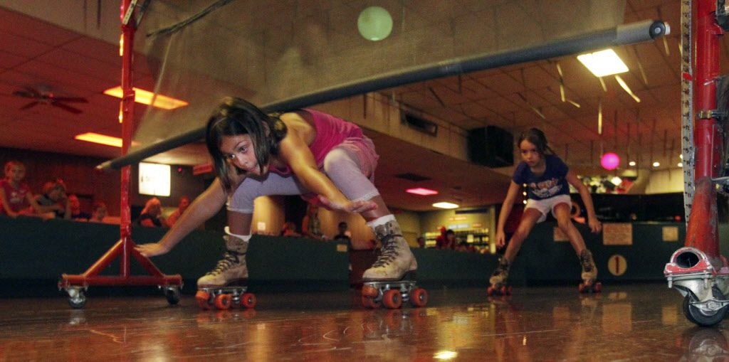 Seven-year-old Olivia Rose Johnson's shoulder touched the limbo bar at 22 inches, knocking her out of White Rock Skate Center's weekly limbo contest in 2011.