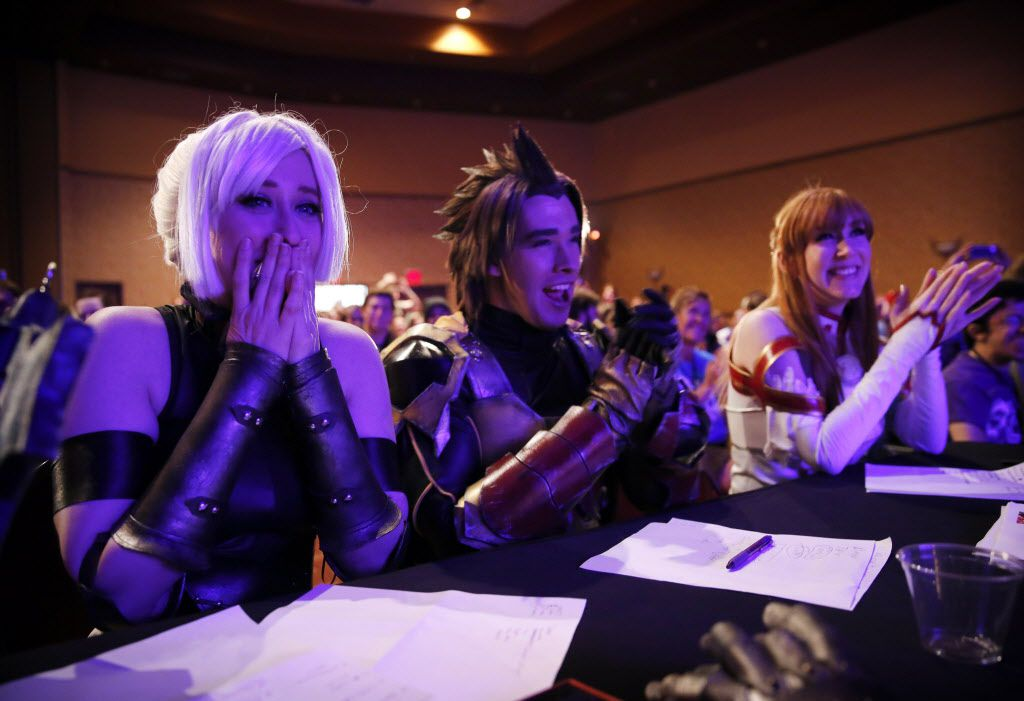 Judges (from left) April Martin of Arlington (Lady Neesa of Final Fantasy), her brother Carl Martin of Killeen, Texas (Terra) and Heidi O'Ferrall of Arlington (Asuna of Sword Art Online) react to the tiniest character in the SGC cosplay contest.