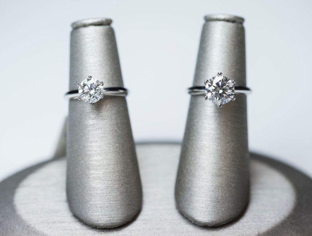 A mined 1.5 carat, I color, VS2 diamond solitaire (left) and an artisan 2.3 carat, I color, VS2 diamond solitaire ring (right) at Spence Diamonds at West Village shopping center in Dallas. The mined diamond is priced at $12,179, and the artisan diamond is priced at $10,739.