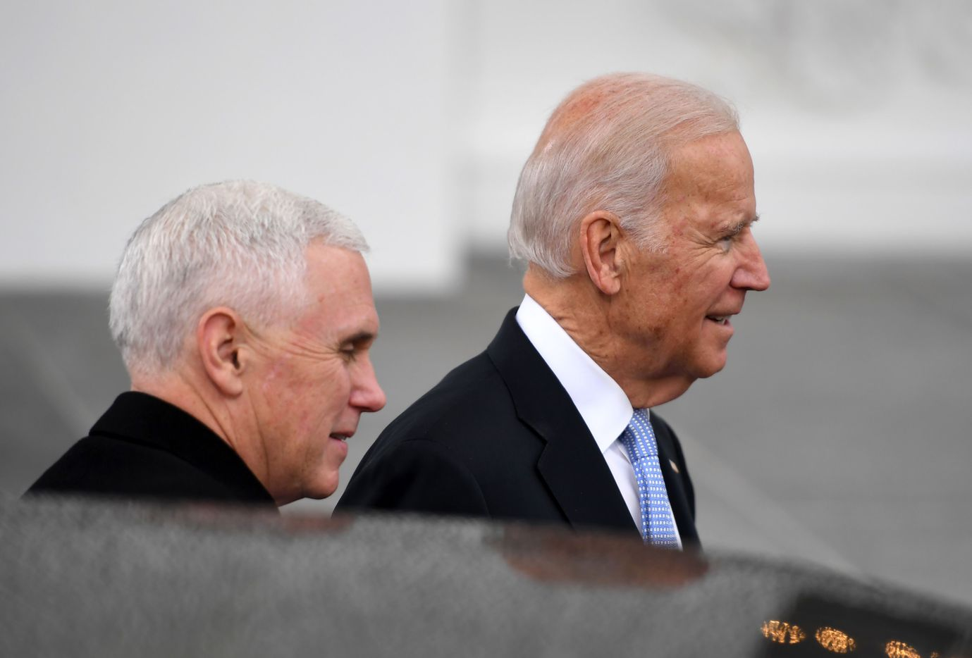 US Vice President Joe Biden greets Vice president-elect Mike Pence to the White House in Washington.