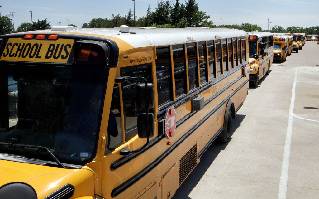 DISD school bus drivers leave Kleberg Service Center to pick up students in Dallas on Monday, May 15, 2017. (David Woo/The Dallas Morning News)