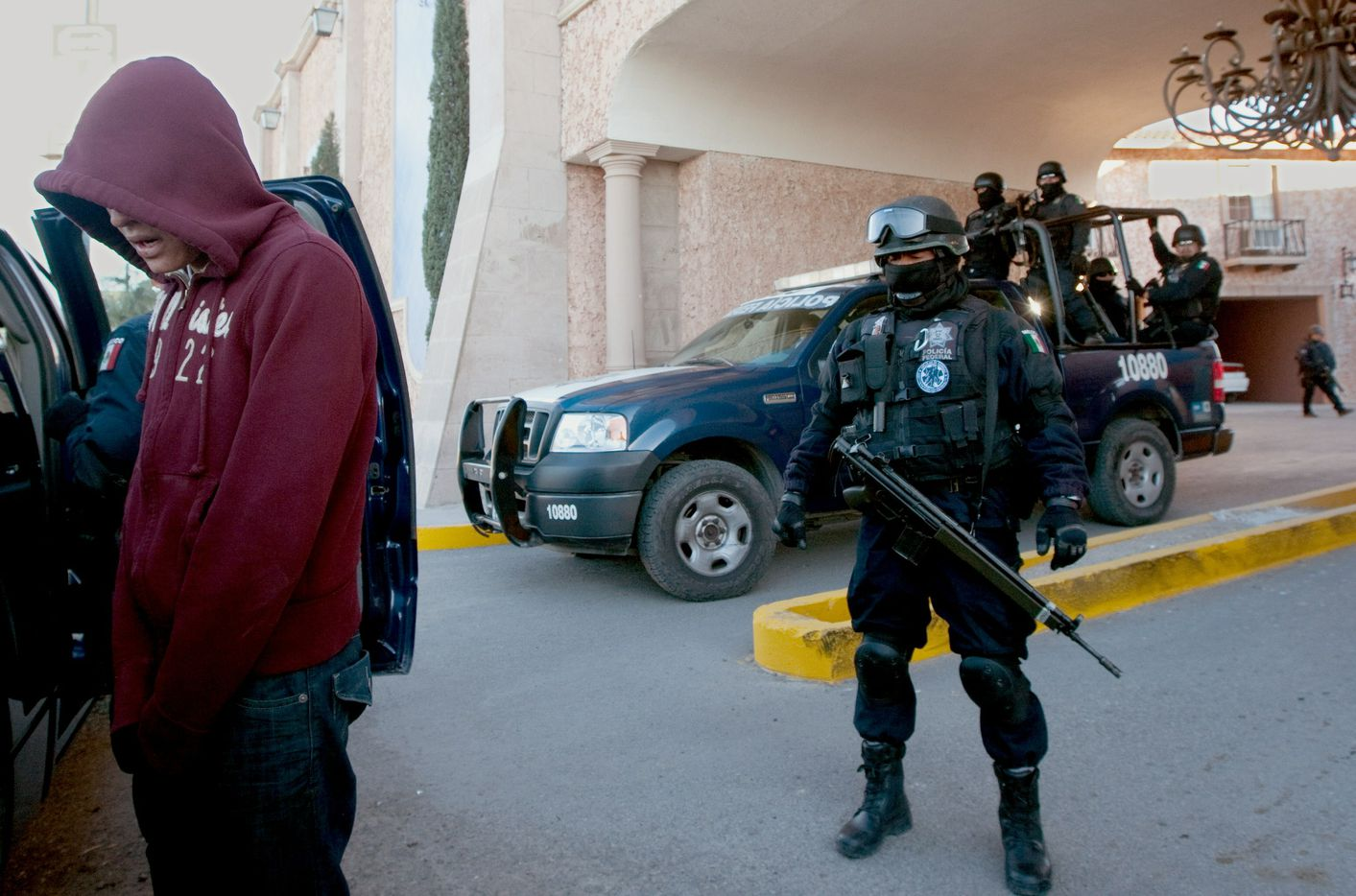 Federal Police check a suspect of an attack against Federal Police in Ciudad Juarez, Mexico, on February 10, 2011.