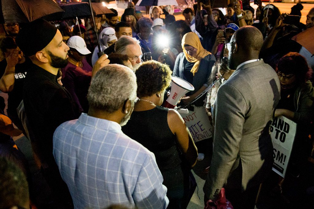 The Rev. Dr. Michael W. Waters led a prayer following a Mothers Against Police Brutality candlelight vigil for Botham Shem Jean at the Jack Evans Police Headquarters on  September 7.