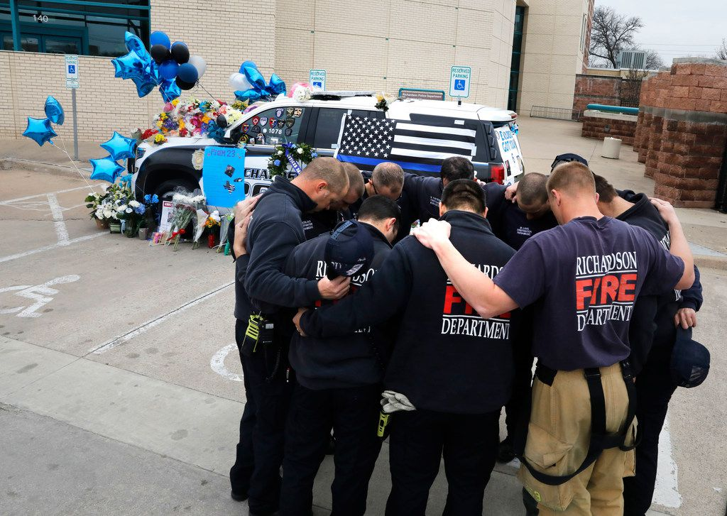Richardson firefighters from Station 4 paid their respects to Officer David Sherrard on Friday at Richardson police headquarters.