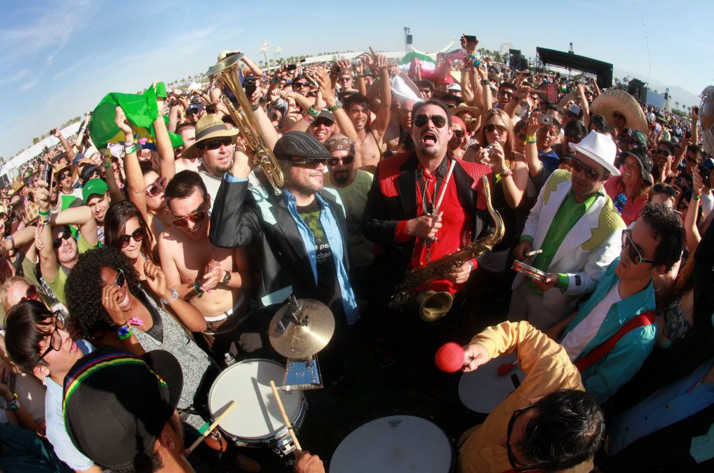 Ozomatli performs from the fan's viewing area during their set at Coachella Valley Music and Arts Festival, Friday, April 15 2011, in Indio, Calif.  (AP Photo/Spencer Weiner)