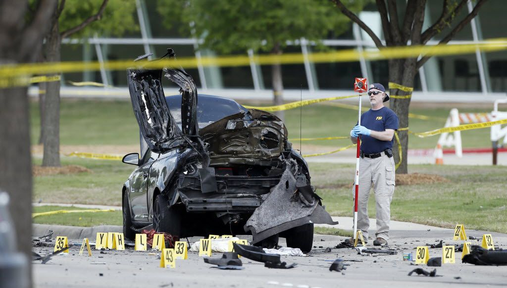 FBI crime scene investigators document evidence outside the Curtis Culwell Center, Monday, May 4, 2015, in Garland.