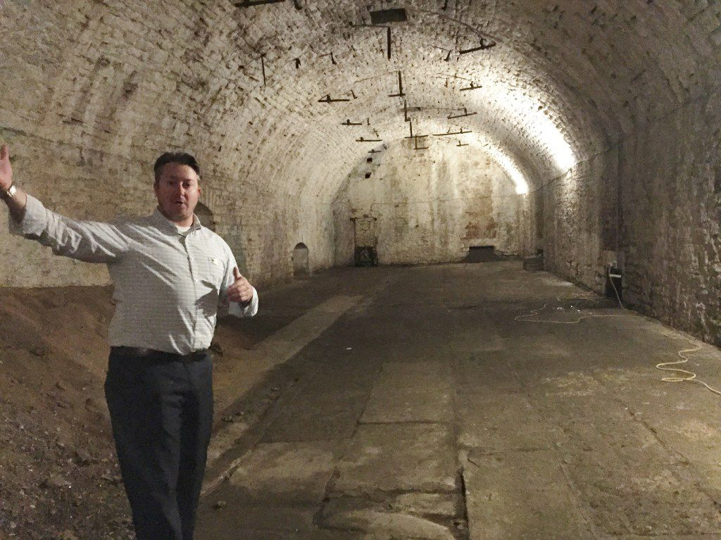 A guide with American Legacy Tours explains the underground cooling and storage system used more than 160 years ago by Cincinnati's beer makers in the Over the Rhine neighborhood.