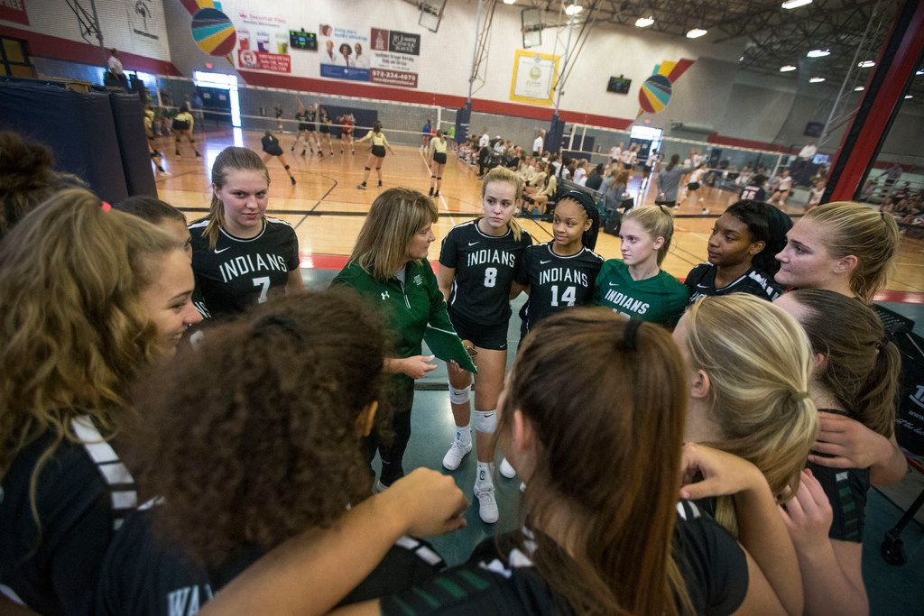 Waxahachie coach Sandy Faussett-Stoops (center), pictured during a match last season, saw her team win Tuesday against Mansfield Lake Ridge, ranked No. 3 in the state in Class 6A. (Carly Geraci/The Dallas Morning News)
