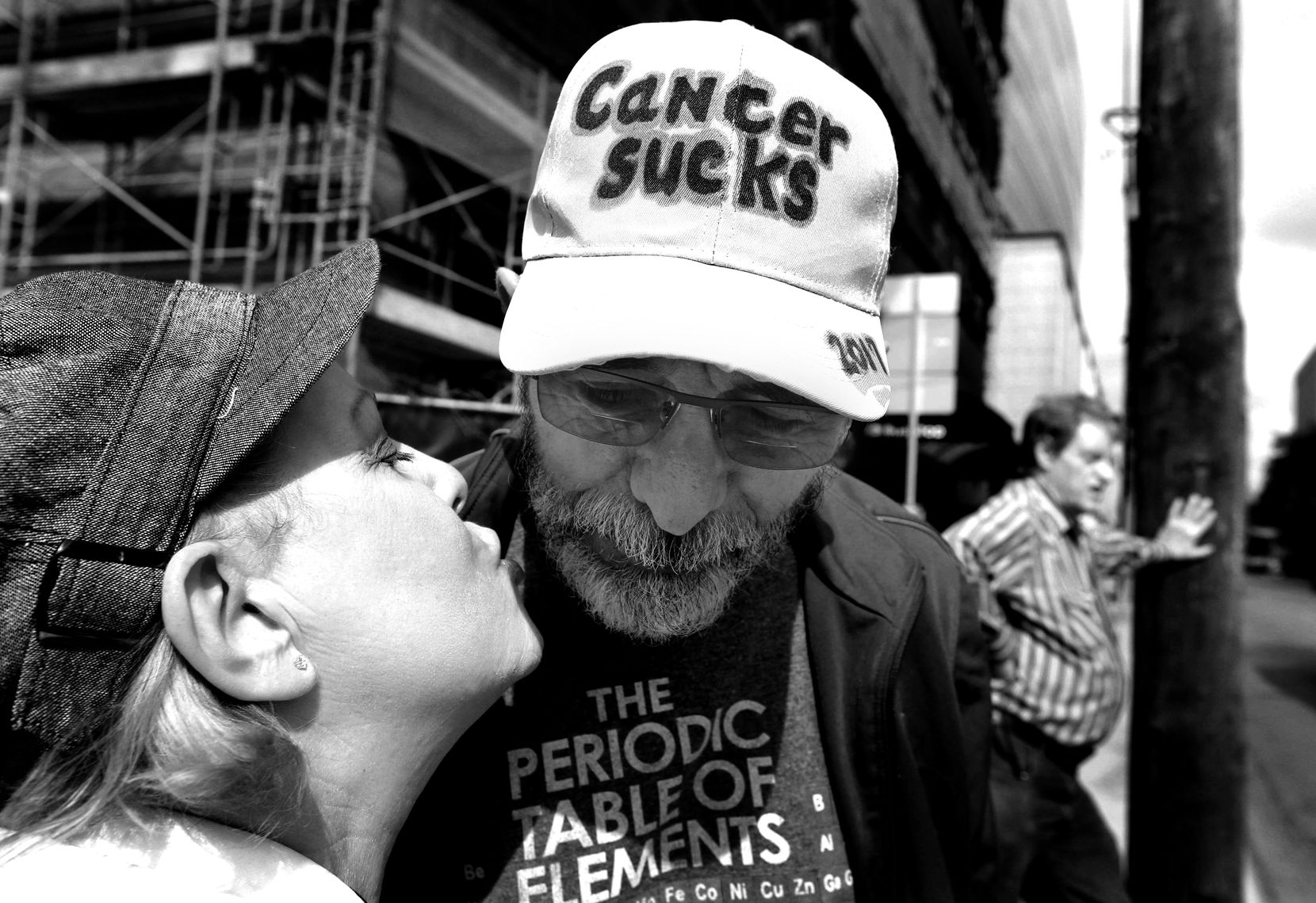 Weiss gets a kiss from his Marni as they wait to cross the street near the hospital. (Louis DeLuca/Staff Photographer)