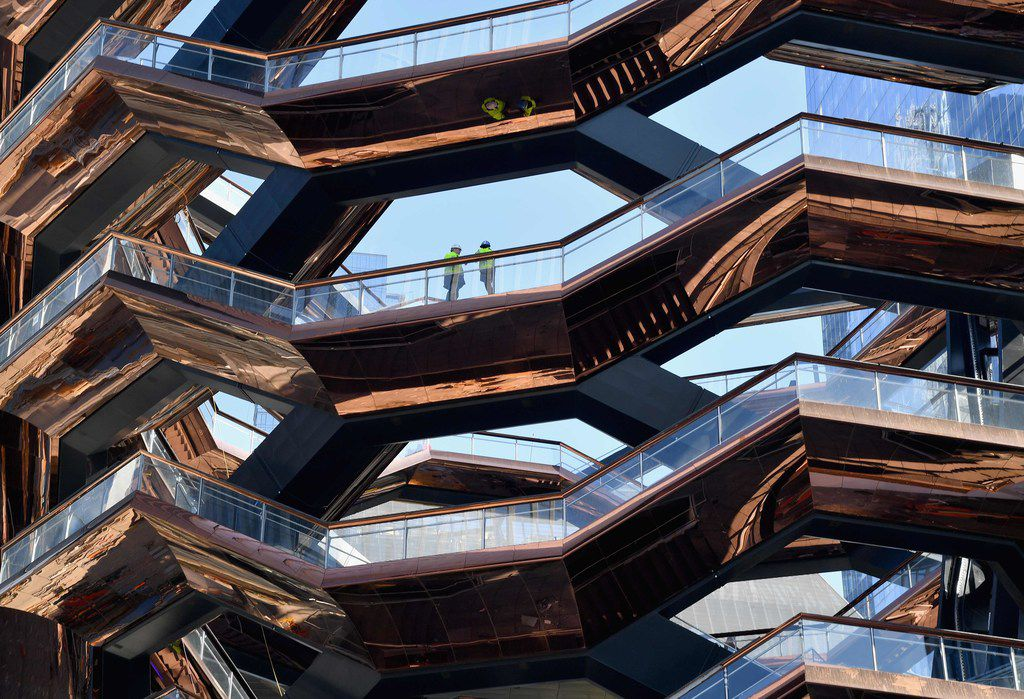 The Hudson Yards development includes a 16-story sculpture called the Vessel, a honeycomb spiral staircase that's meant to be climbed.