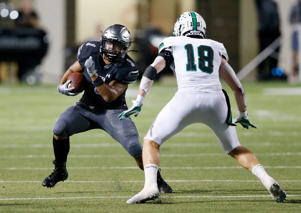 Denton Guyer's Kaedric Cobbs (1) attempts to shake Southlake Carroll's Preston Forney (18) on a run play during the first half of play at C.H. Collins Complex in Denton, on Friday, October 4, 2019. (Vernon Bryant/The Dallas Morning News)