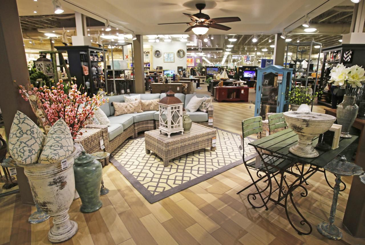 Furniture displays at Nebraska Furniture Mart are arranged by style, and the floor is arranged with the most expensive items at the front of the store near the design center.
