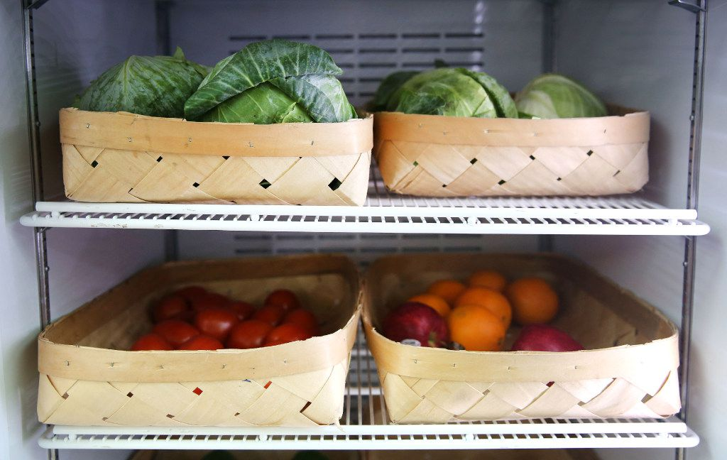 Fresh produce inside a Food for Good fridge at Hackney Food in the Mill City neighborhood in South Dallas. (Rose Baca/The Dallas Morning News)