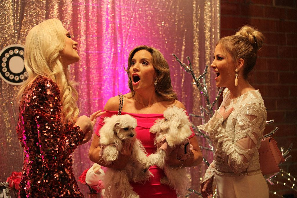 Kameron Westcott, Carey Deuber and Stephanie Hollman (left to right) react appropriately to talk of pink dog food at the launch party for SparkleDog, Kameron's fantasy of a pet food.