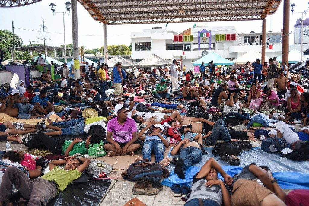 "Honduran migrants, taking part in a caravan heading to the US, rest during a stop in Mapastepec, Chiapas state, Mexico, on October 24, 2018. - Thousands of mainly Honduran migrants heading to the United States, a caravan President Donald Trump has called an ""assault on our country"", continued their march to the US after one-day rest in Huixtla, Chiapas state in Mexico. (Photo by Johan ORDONEZ / AFP)JOHAN ORDONEZ/AFP/Getty Images"