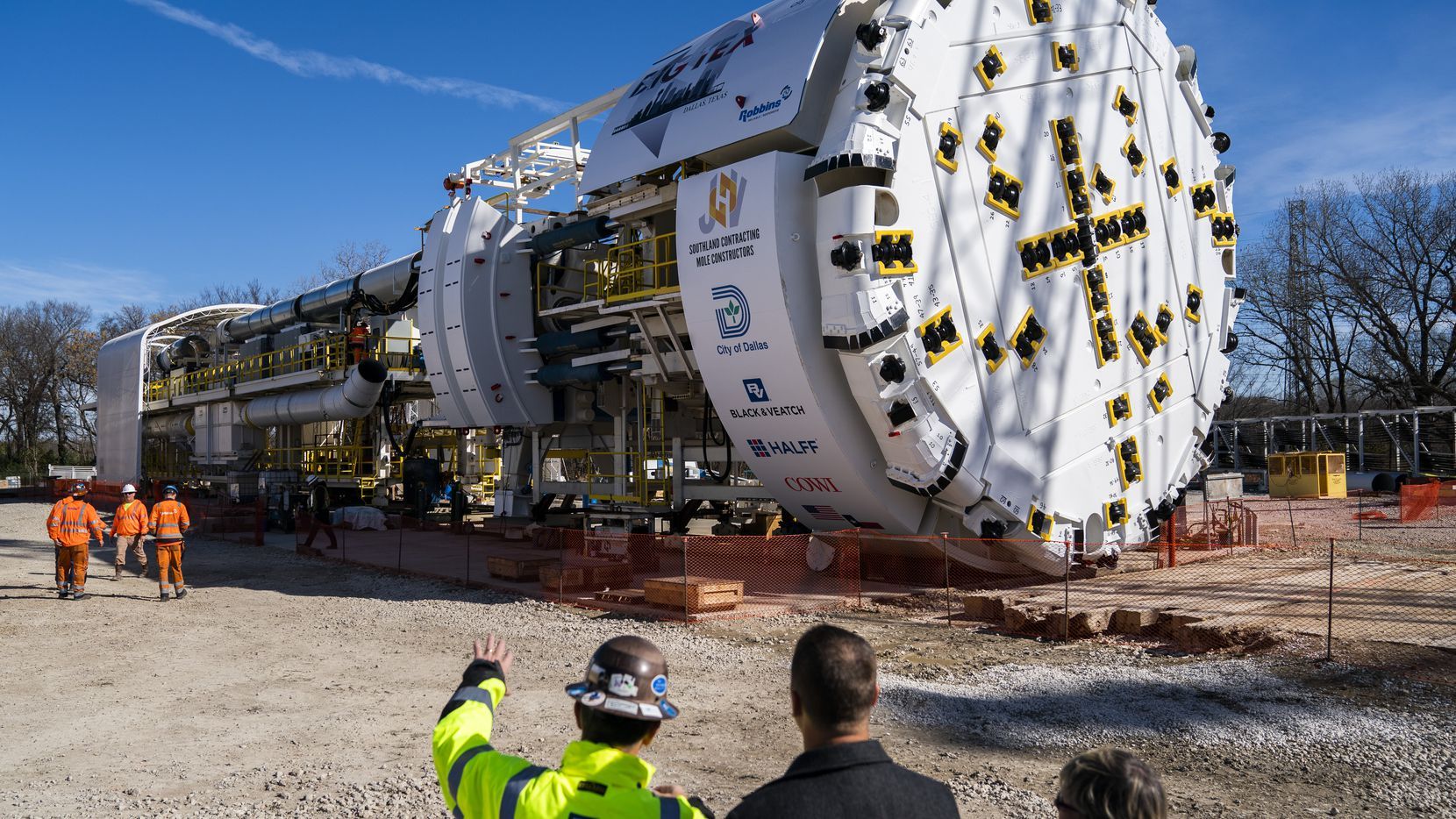 Guests and workers take a look at a fully assembled tunnel boring machine on Tuesday at what will be the south end of the Mill Creek Tunnel in Dallas. The next step for the machine, named Big Tex, will be disassembly and reassembly underground.