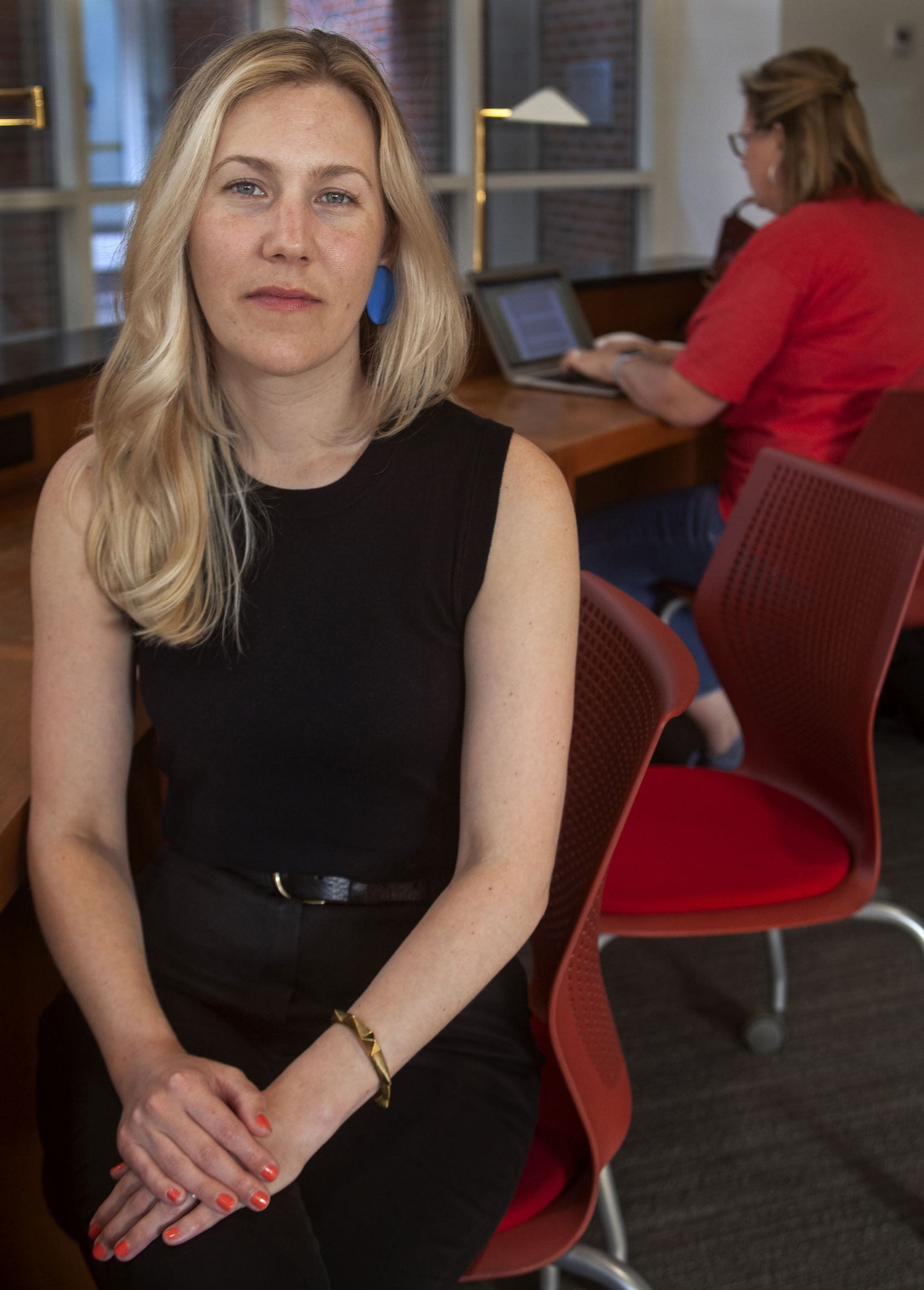 Artist Elizabeth Moran, photographed at Hamon Arts Library at Southern Methodist University, took a deep dive into the world of fact checkers in the early days of Time magazine.