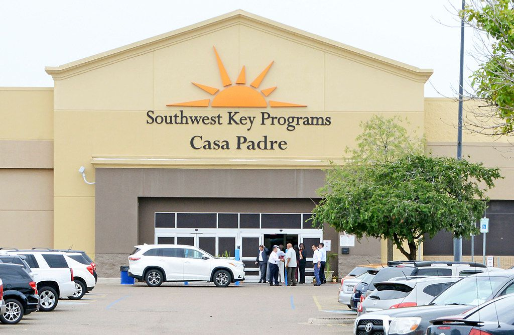 Dignitaries take a tour of Southwest Key Programs Casa Padre, a U.S. immigration facility in Brownsville, on June 18, 2018, where children are detained. (Miguel Roberts/The Brownsville Herald via AP)