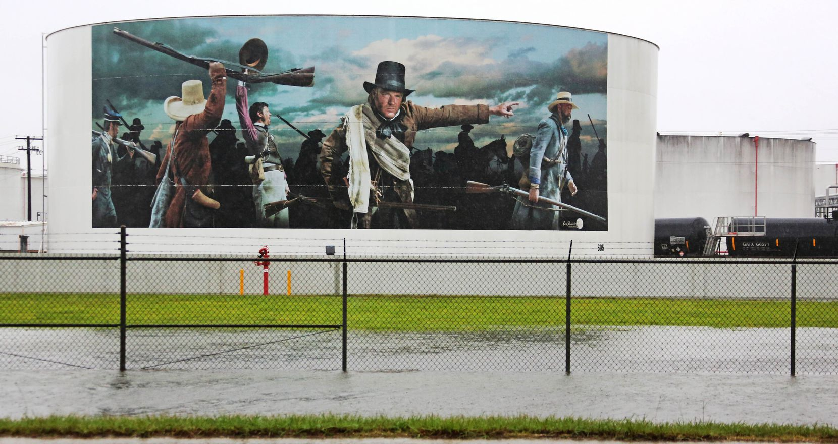 A painted oil tank bearing a painting of the Battle of San Jacinto is seen as the roadside fills up with water near the San Jacinto Monument in Houston as Hurricane Harvey spreads a wide blanket of rain southeast of Houston on Saturday, August 26, 2017.