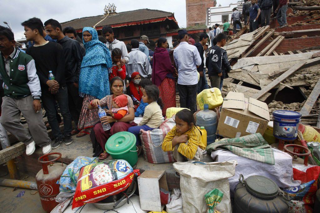 People gather beside damaged buildings in Kathmandu, Nepal, after a 7.8-magnitude earthquake rocked the area on Saturday, April 25, 2015. (Pratap Thapa/Xinhua/Zuma Press/TNS)