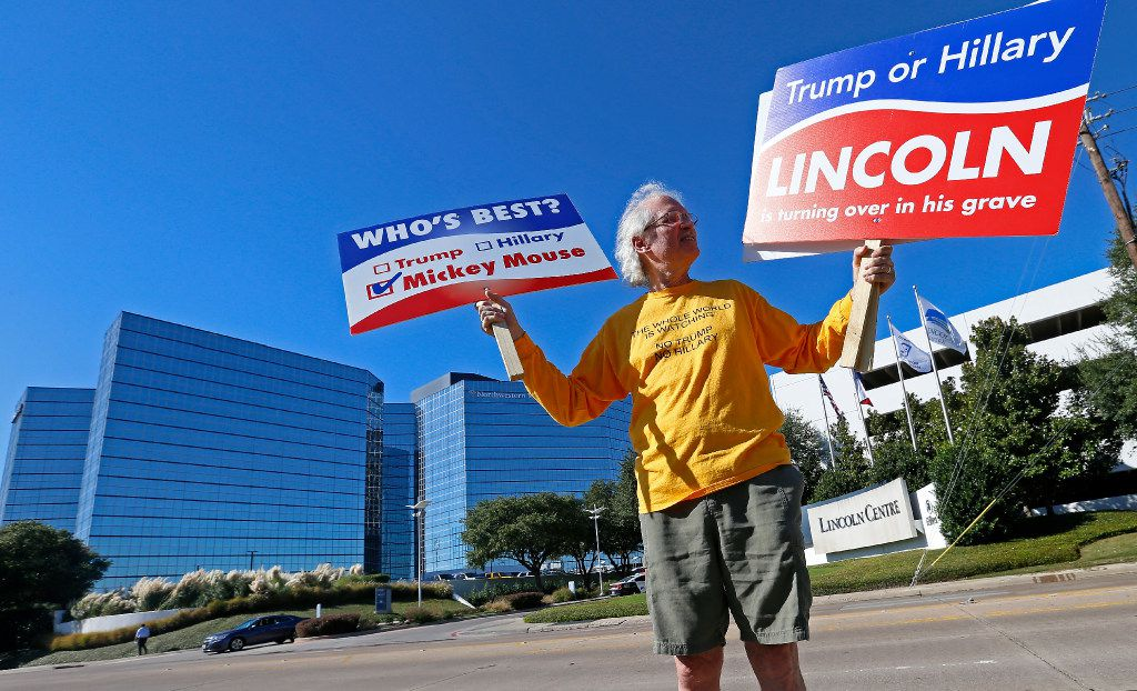 Independent voter Tom Mitchell protests near the Hilton Dallas Lincoln Hotel where a fundraising event for Trump is held in Dallas, Tuesday, Oct. 11, 2016. (Jae S. Lee/The Dallas Morning News)