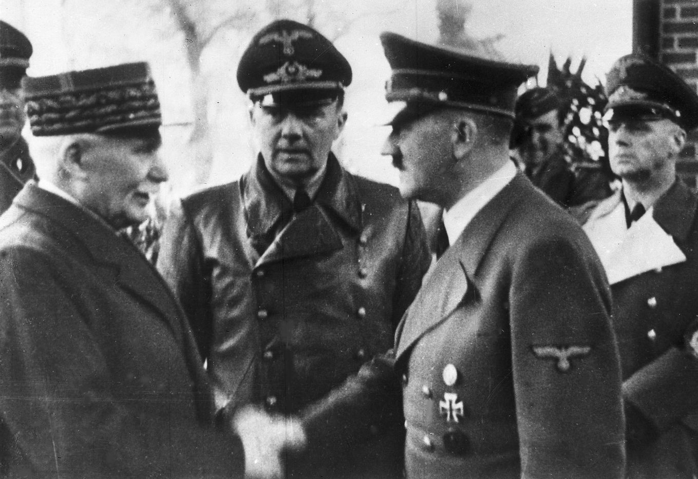 A photo taken Oct. 24, 1940, shows Adolf Hitler (right) shaking hands with Head of State of Vichy France Philippe Petain in occupied France.