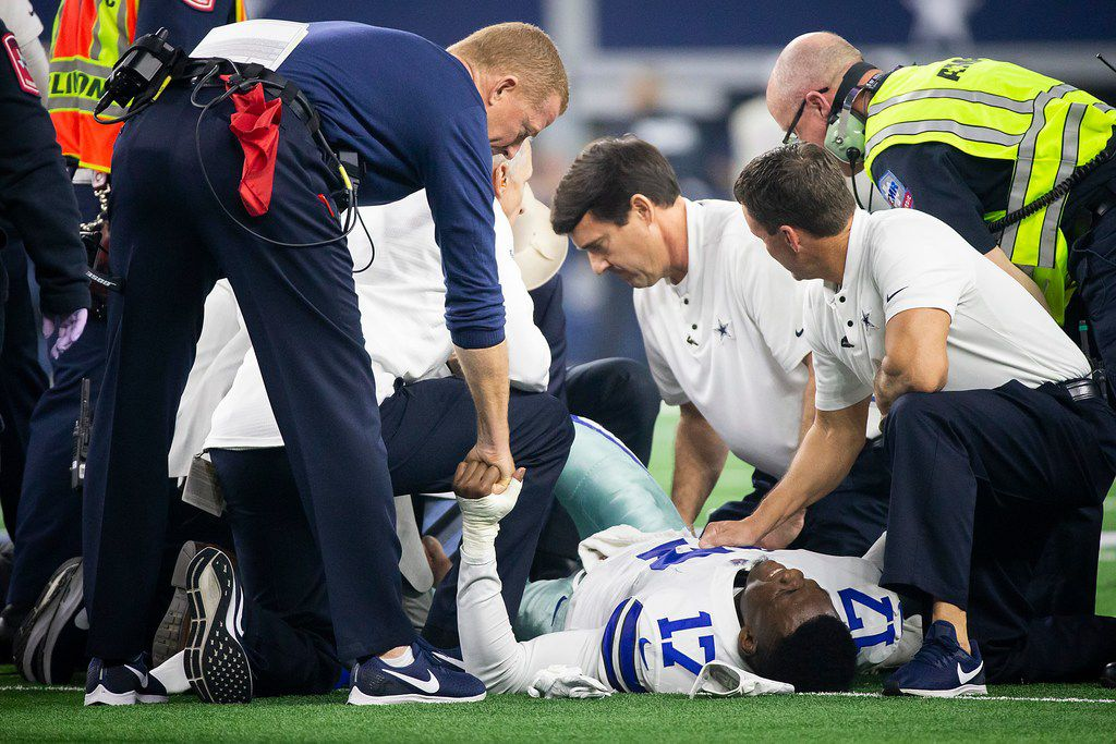 Dallas Cowboys head coach Jason Garrett checks on wide receiver Allen Hurns (17) as he receives medical attention after being injured on a play during the first half of an NFL wild-card playoff football game against the Seattle Seahawks at AT&T Stadium on Saturday, Jan. 5, 2019, in Arlington. (Smiley N. Pool/The Dallas Morning News)
