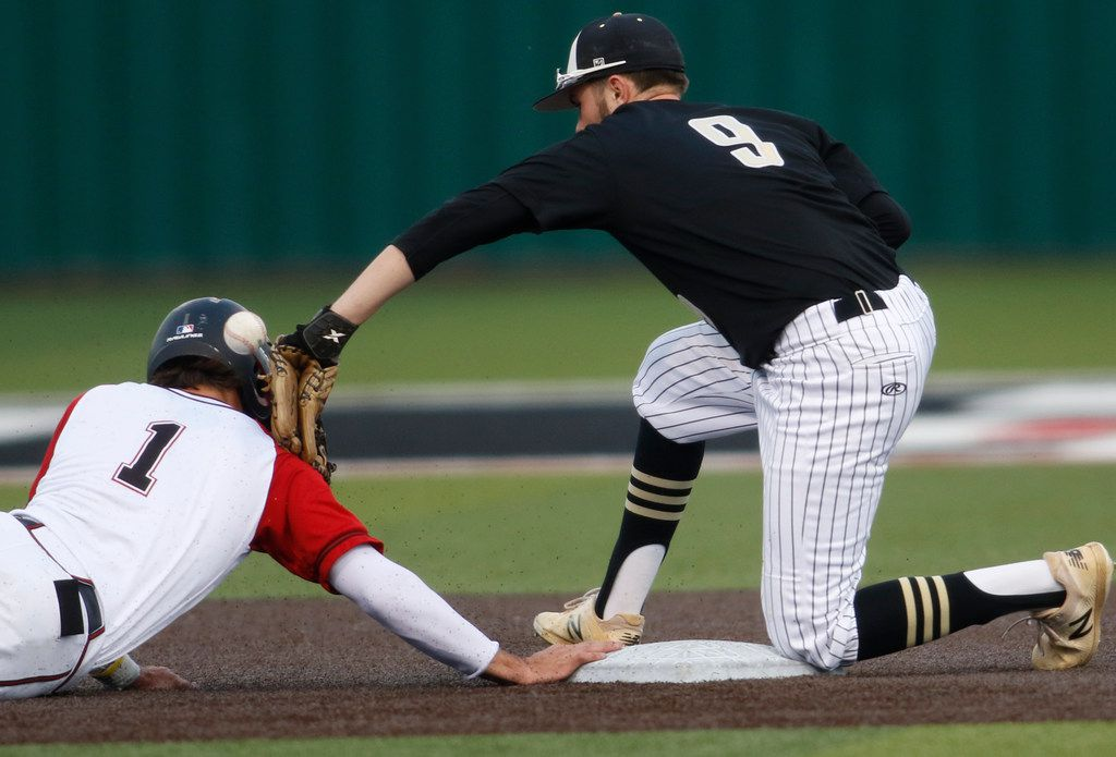 Rockwall Heath baserunner Casey Curtin (1) jars the ball loose from the tag of The Colony shortstop Shay Hartis (9) to safely return to 2nd base during second inning play. The two teams played their non-district baseball game at Rockwall Heath High School in Rockwall, Texas on April 16, 2019. (Steve Hamm/ Special Contributor)
