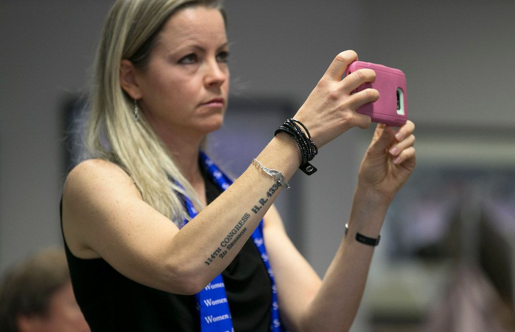 Erin Miller of Washington DC, records the discussion of keeping the Women Airforce Service Pilots (WASP) in the Texas social studies curriculum at the State Board of Education meeting in the William B. Travis Building on Tuesday November 13, 2018.    [JAY JANNER/AMERICAN-STATESMAN]
