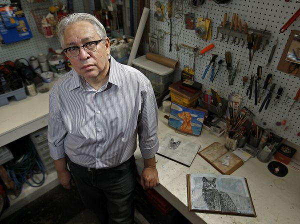 James Chefchis, 61, of Dallas, is an artist who specializes in pet portraits for which he uses books as a canvas. He often works in an area in the back of B Gover Limited home and antiques store on Slocum Street near downtown Dallas on Saturday, June 16, 2012.