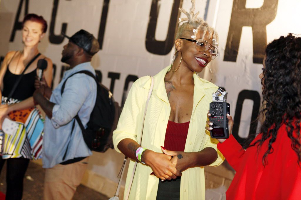 """Local rapper Cyletha """"Lythal"""" Gooley, left, conducts an interview on the red carpet during The D.O.C. Straight Outta Dallas Hip Hop event, on Saturday, Oct. 17, 2015 at The Bomb Factory in Dallas."""