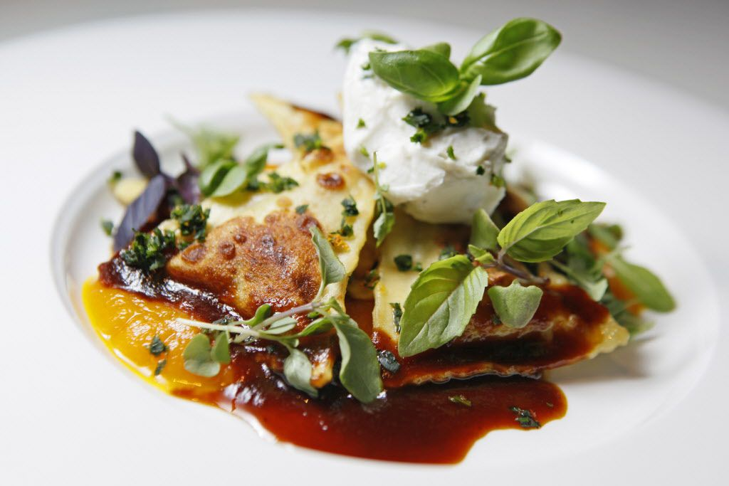 Butter-browned ravioli filled with lamb belly and ricotta atop butternut squash puree