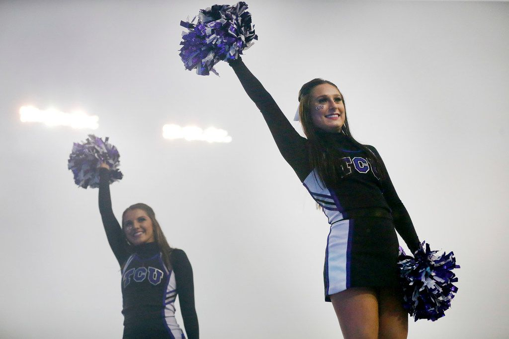 Smoke from pyrotechnics fill the stadium, as TCU Horned Frogs cheerleaders celebrate a touchdown against the West Virginia Mountaineers at Amon G. Carter Stadium in Fort Worth, Friday, November 29, 2019. The Horned Frogs lost though, 20-17. (Tom Fox/The Dallas Morning News)