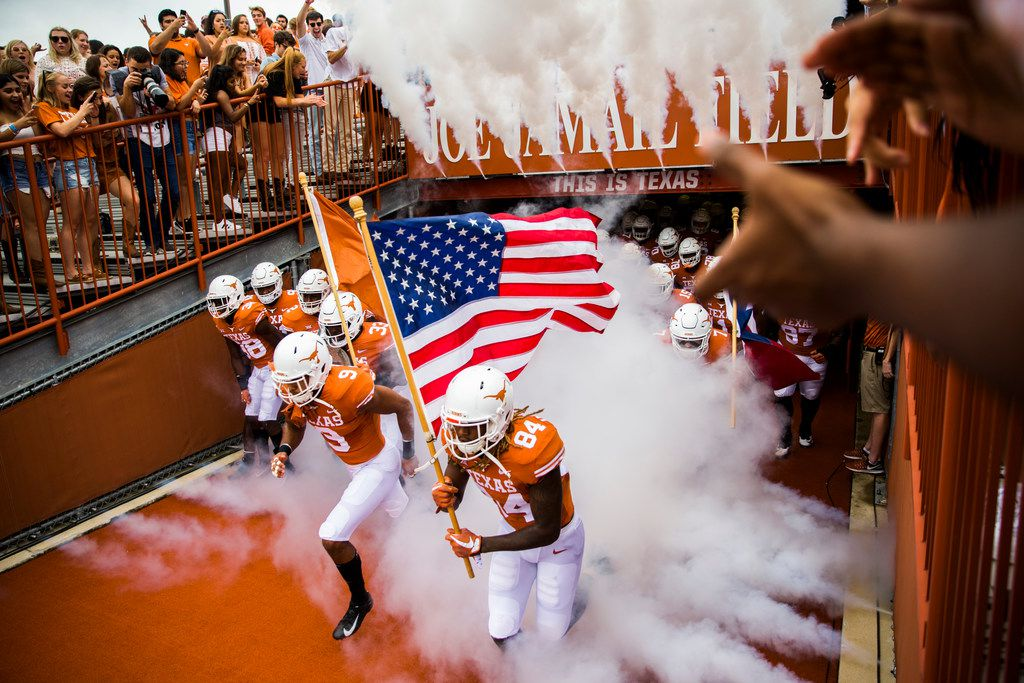 Texas Longhorns players enter the stadium before a college football game between TCU and the University of Texas on Saturday, September 22, 2018 at Darrell K Royal - Texas Memorial Stadium in Austin. (Ashley Landis/The Dallas Morning News)