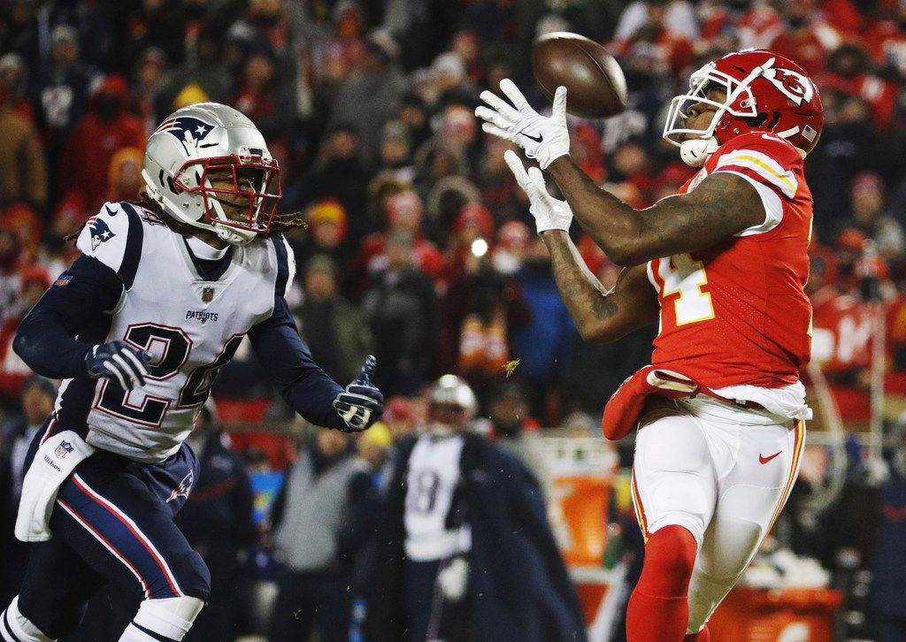 FILE - Kansas City Chiefs wide receiver Sammy Watkins (14) makes a reception against New England Patriots cornerback Stephon Gilmore (24) during the second half of the AFC Championship NFL football game, Sunday, Jan. 20, 2019, in Kansas City, Mo. (AP Photo/Charlie Riedel)