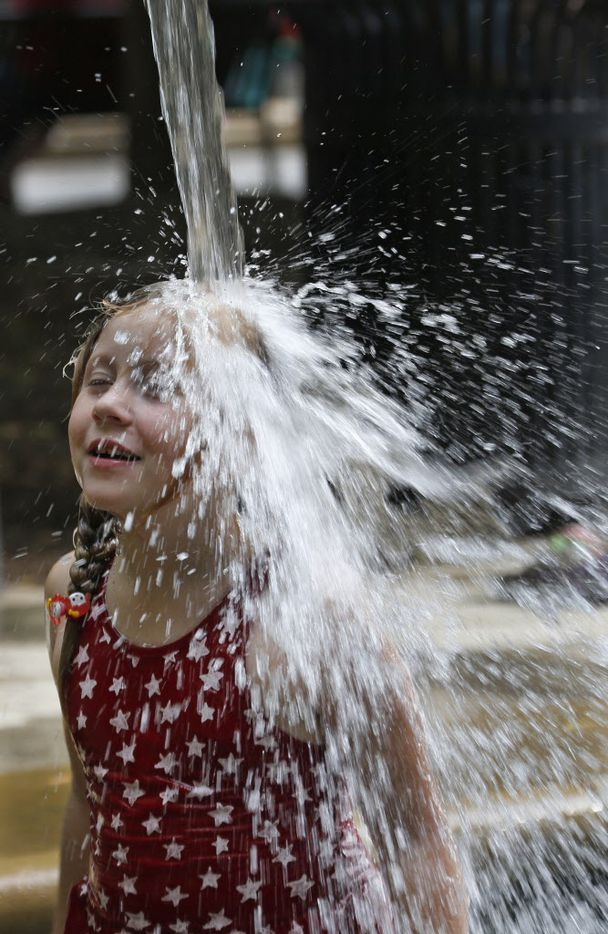 A young festival goer cools off during the City of Addison's Kaboom Town celebration on Friday, July 3, 2015.