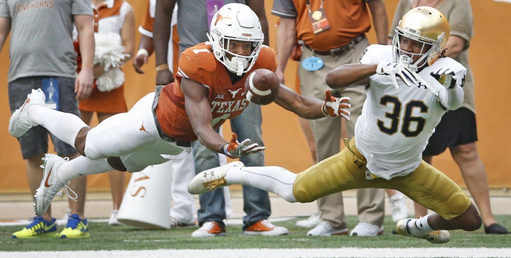 Texas wide receiver John Burt (1) can't corral a long pass in the second quarter as Notre Dame cornerback Cole Luke (36) defends during the Notre Dame Fighting Irish vs. the University of Texas Longhorns NCAA football game at Darrell K. Royal Memorial Stadium in Austin on Sunday, September 4, 2016. (Louis DeLuca/The Dallas Morning News)