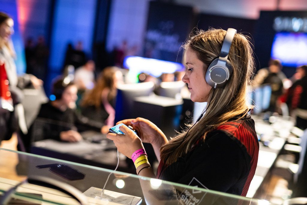 LEIPZIG, GERMANY - FEBRUARY 15: A participant stands with a mobile phone to play a video game at the 2019 DreamHack video gaming festival on February 15, 2019 in Leipzig, Germany. The three-day event brings together gaming enthusiasts, mainly from German-speaking countries, for events including eSports tournaments, cosplay contests and a LAN party with 1,500 participants.