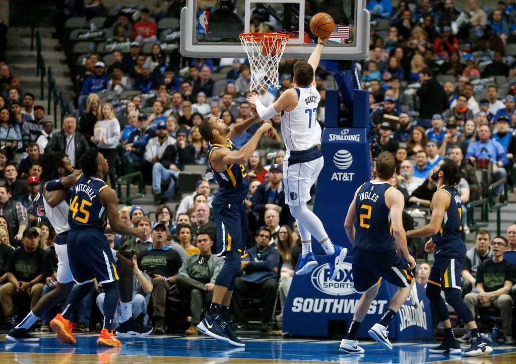 Dallas Mavericks forward Luka Doncic (77) lays the ball up in front of Utah Jazz center Rudy Gobert (27) during the first half of play at American Airlines Center in Dallas on Wednesday, November 14, 2018. (Vernon Bryant/The Dallas Morning News)