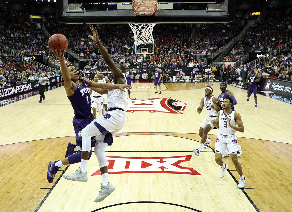 KANSAS CITY, MISSOURI - MARCH 14:  Desmond Bane #1 of the TCU Horned Frogs drives on a fast break as Makol Mawien #14 of the Kansas State Wildcats defends during the quarterfinal game of the Big 12 Basketball Tournament at Sprint Center on March 14, 2019 in Kansas City, Missouri. (Photo by Jamie Squire/Getty Images)