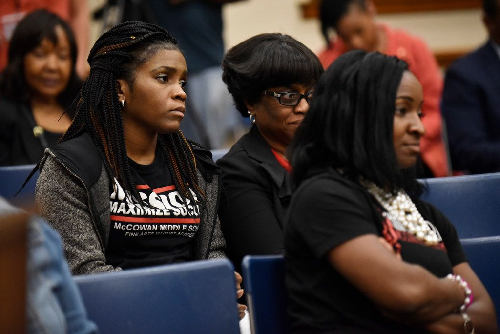 DeSoto school teachers, who did not want to be identified by name, listen to DeSoto ISD superintendent make a decision to continue talks at a later time to terminate certain jobs within the district during a DeSoto ISD school board meeting on  April 29.