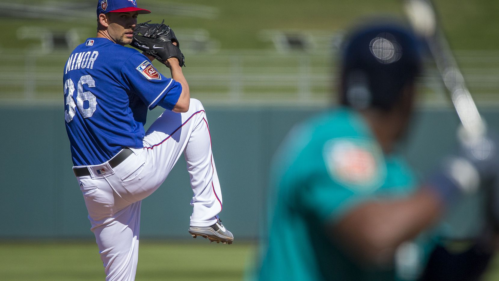 Texas Rangers pitcher Mike Minor pitches during the fourth inning of a spring training baseball game against the Seattle Mariners on Sunday, March 4, 2018, in Surprise, Ariz. (Smiley N. Pool/The Dallas Morning News)