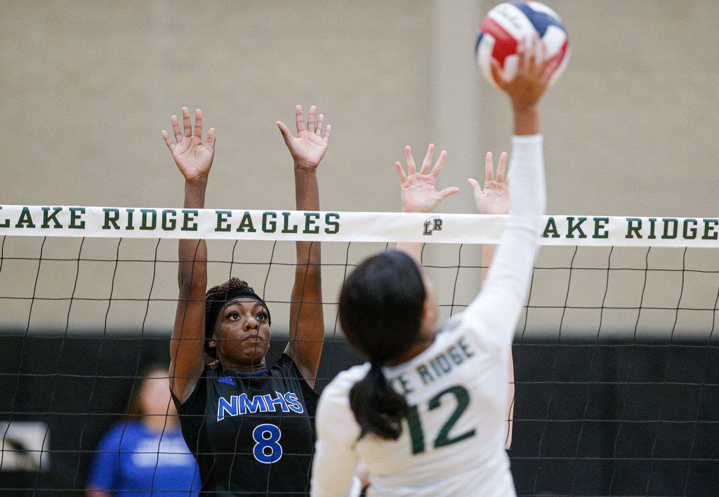 Mansfield Lake Ridge junior Caiya Artis (12) spikes the ball as North Mesquite senior Kayla Pope (8) attempts to block during a high school volleyball game at Mansfield Lake Ridge High school in Mansfield, Tuesday, August 27, 2019. Lake Ridge won in three sets. (Brandon Wade/Special Contributor)