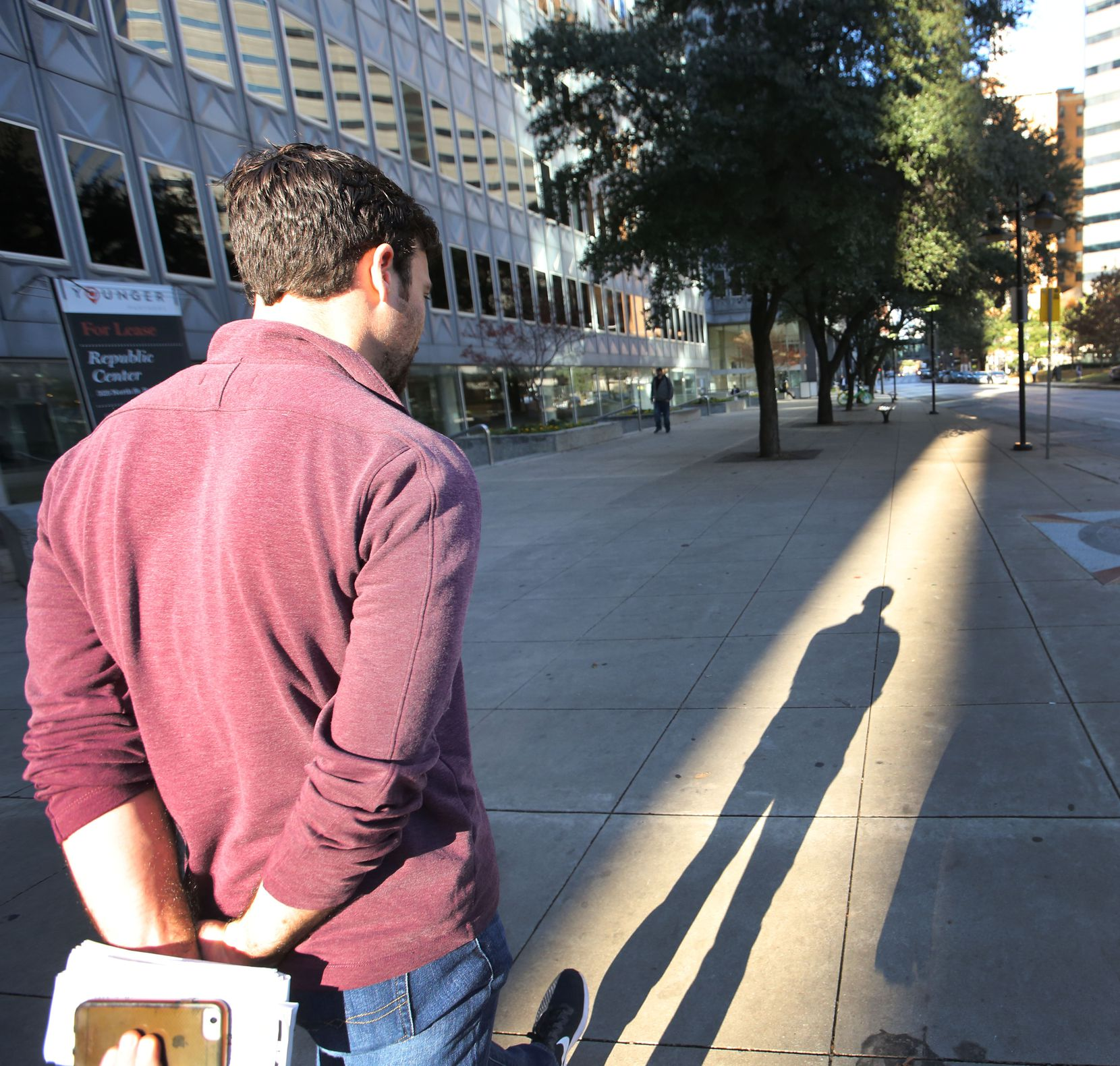 Dallas Morning News reporter Brendan Meyer walks from the office on Commerce Street to St. Paul Station as he takes a mass transit excursion from downtown Dallas to Fort Worth.