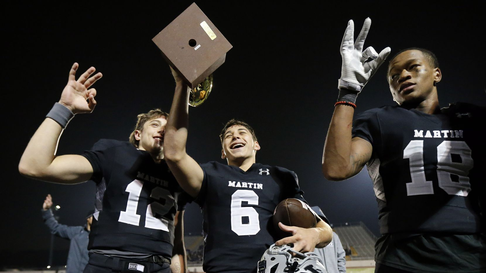 Martin quarterback Zach Mundell (6) celebrates their District 4-6A title with teammates Nick Panella (12) and Morice Blackwell after defeating Bowie at Maverick Stadium in Arlington, Texas, Thursday, November 7, 2019. Martin won the title, 44-19. (Tom Fox/The Dallas Morning News)